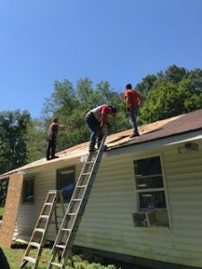 Our supermen working on the roof.